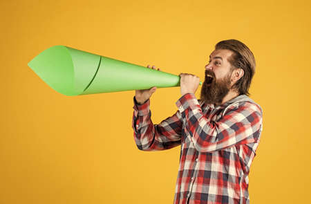 propaganda concept. urge the public. Do not be afraid to express your opinion. free man shouting into megaphone. Handsome man shouting through speaker. loud announcement. dont be silent. vote