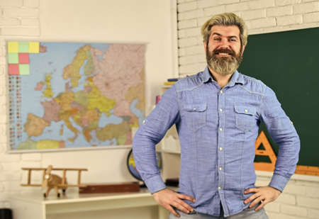 School subject. History and geography. Science concept. Mature bearded teacher in classroom. Private lesson. Back to school. Study with interest. Man mentoring school projects. Basic education Stock fotó