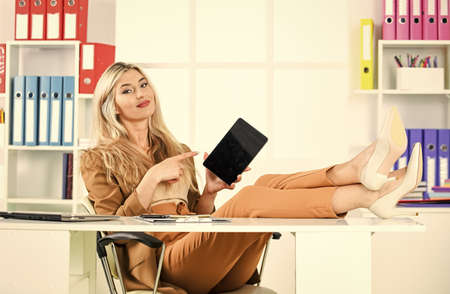 smiling woman ceo use modern tablet. office life. new technology and digital device. business success concept. boss relax at table. successful businesswoman watch on tablet. business full of surity