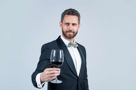 man wear office costume. formal event. businessman drink red wine. cheers for happy valentines day. alcohol drinking. handsome male on romantic date. unshaven man with wine glass. sommelier
