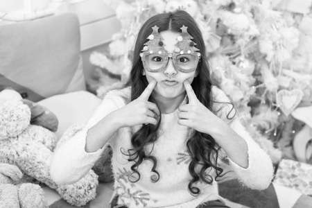 Brighten up your look. Little child with Christmas look make fun. Party look of small kid. Happy girl celebrate xmas and new year. Festive and stylish look Stok Fotoğraf