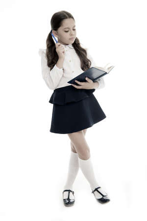 Schoolgirl read book isolated on white. Little child hold textbook with pen. Dedicated to study. Back to school. Home schooling education. Knowledge day. Adorable bookworm. Back to school