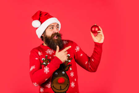 Run xmas party. Winter inspiration. New year party decor. Decor shop sales. Prepare for holiday. Ready to celebrate. Bearded man hold christmas decoration. Decorate your home. Organise party Stock Photo