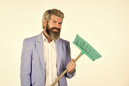 Where start cleaning. Clear reputation. Hipster hold cleaning tool. Man use broom. Businessman sweeping office. Unemployment and business reduction. Staff reductions concept. Business cost reduction 版權商用圖片