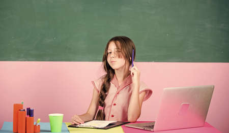 future career. 4G internet for weblog. small girl pupil with laptop. childhood study online. knowledge day. smart school girl in classroom. back to school. Online education. Working on project