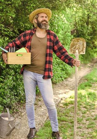 man gardening in his garden. I work in the spring garden. Digging spring soil with a shovel. man gardening in greenhouse. Male gardener use shovel at spring garden background. health and ecology