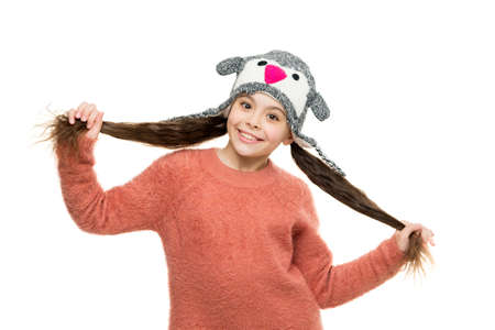 its cosy sweater. get ready for winter holiday. homemade knit. little playful girl in winter look smiling. Fashion concept. cute beauty isolated on white. warm in any weather. let it snow. ski resort