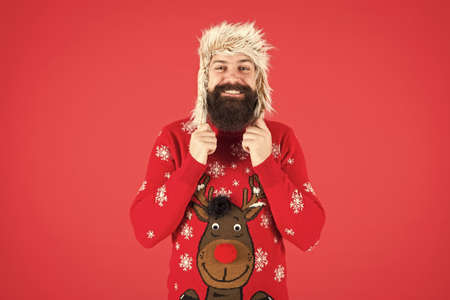 completely happy in new year. merry christmas. male winter fashion. feel happiness about holidays. wear warm clothes in cold season. hipster with beard in favorite sweater. knitwear and fur accessory