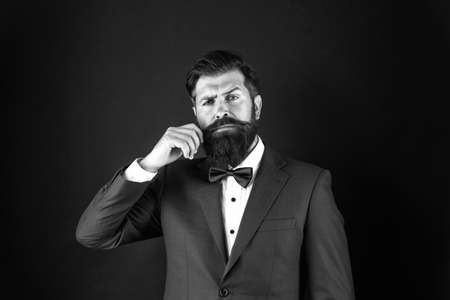 Masculine aesthetic. Male fashion and aesthetic. Businessman formal outfit. Classic style aesthetic. Looking good does not have to take too much effort. Well groomed man with beard in suit jacket