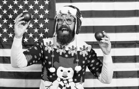 Celebrate today. American man celebrate winter holidays. Patriotic Santa on stars and stripes background. Celebrate Christmas and new year the american way. Seasons greetings. Keep calm and celebrate