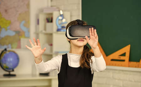 schoolchild using virtual reality. virtual reality headset. teenage schoolgirl in classroom. back to school. In a Computer Science Class. Works on a Programing Project. vr technology Imagens