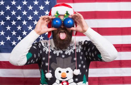 Big eyes. Excited look. Happy to see. Bearded american man. Celebrate Christmas and new year american way. Winter greetings. Having fun. Great american Christmas. Happy santa american flag background