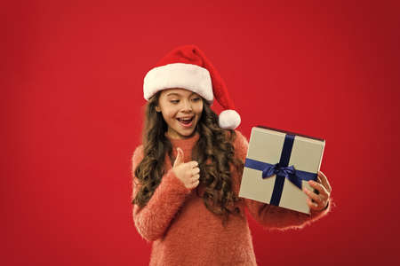 New year party. Santa claus kid. Little girl child in santa red hat. Christmas shopping. Present for Xmas. Childhood. Happy winter holidays. Small girl. Christmas is coming