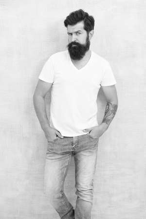 Sexy handsome. handsome hipster jeans. male fashion trends. Simple and casual summer. Brutal macho gray background. Male temper brutality. bearded man radiate masculinity. physical attractiveness