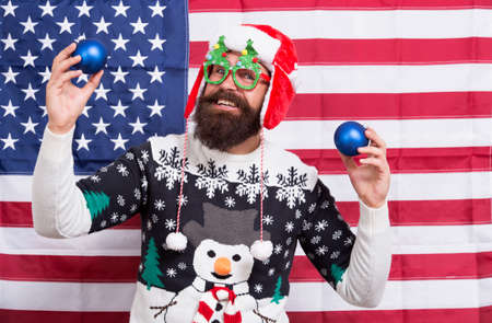 Positivity concept. Happy new year. Happy santa celebrate xmas and new year. Smiling guy. Happy holidays. Bearded man happy smiling american flag background. Merry Christmas. Holiday season in USA