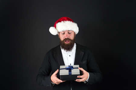 Boxing day. Christmas spirit concept. Manager celebrate new year. Cheerful mood. Christmas party. Corporate holiday ideas. Happiness and joy. Corporate christmas party. Man bearded hipster santa hat