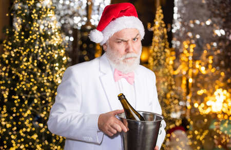 Happy bearded man. Man santa hat drink sparkling wine. Winter holidays. Santa drink champagne. Winter celebration. New year gifts. Winter tradition. Adult party concept. Alcohol. Merry christmas