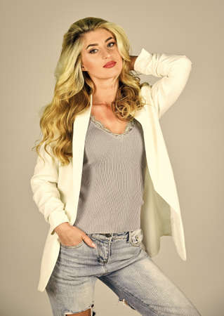 In her own style. girl after hairdresser salon. follow personal trend. beautiful healthy hair. and confident. fashion model has curly hair. beauty in jacket. blonde woman with stylish make up