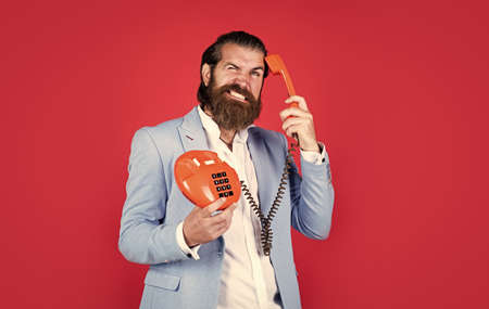 bearded man in a suit holding retro phone. stay connected. customer service concept. Bearded man with telephone handset. business call concept. man talking to vintage phone. Solutions enabled