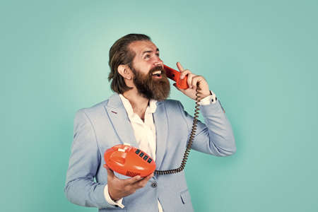 Empowering People. communication. idea of conversation. man speak on phone. happy man with retro phone. brutal bearded man hold vintage telephone. concept of technology in modern life