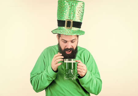 Irish pub. Green beer mug. Drinking beer part of celebration. Discover culture. Alcohol consumption integral part saint patricks day. Irish tradition. Man brutal bearded hipster drink pint beer
