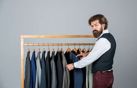 His look is great. Fashion design studio. Male fashion designer. Individual measures hand of man. Man ordering business suit posing indoor. Tailor measures man. stylish business man at workspace