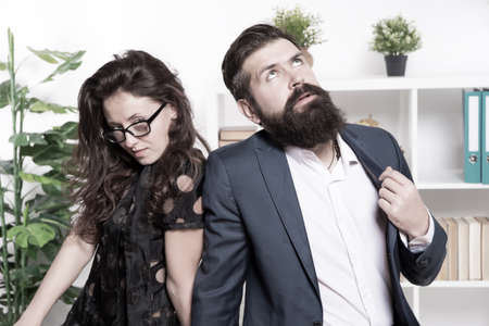 Tired man with beard and woman. Young coworkers. Businesspeople. Teamwork. Business couple in office. Formal fashion dress code. Overtime. Tired from work. Tired office worker. feeling tired