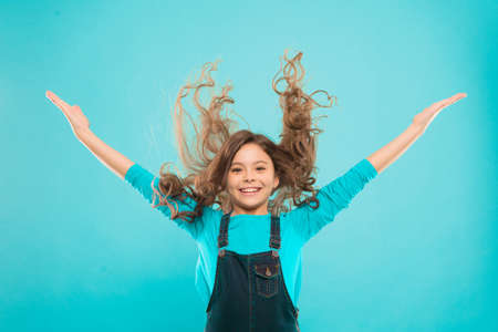 Easy tips making hairstyle for kids. Small child long hair. Girl active kid with long gorgeous hair. Extra fresh dry shampoo. Fresh it up. Strong and healthy hair concept. Nice and tidy hairstyle