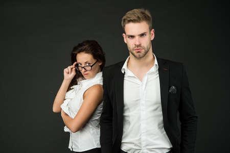 Professional couple of sexy woman and handsome man in formal wear dark background, fashion Stock fotó