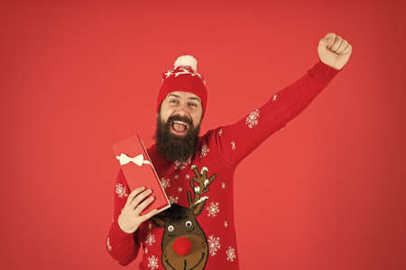 seasonal discounts. present from santa. happy new year. cheerful bearded man after successful shopping. man hipster celebrate winter holidays. his favorite sweater. merry christmas. got xmas gift