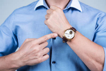 Value your time. Manager cropped view point finger at wrist watch. Time management. Meeting deadline. Punctuality and promptness. Business appointment. Fashion accessory