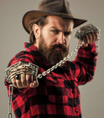 you are next. problem solving. man in captivity. concept applicable for business. man tearing heavy steel chain by hands. conceptual symbol of freedom. male fashion. strong man with chains