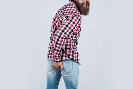 he has diarrhea. mature hipster with beard has diarrhea. brutal guy with moustache. rectal problems. bearded man wear checkered shirt. brutal man feeling discomfort. male health care. I need help