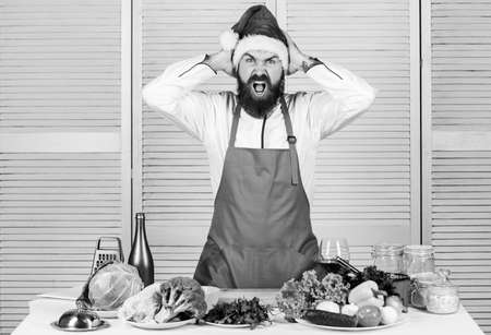 Happy bearded man. chef recipe. Cuisine culinary. Vitamin. Dieting organic food. Vegetarian salad with fresh vegetables. Healthy food cooking. Mature hipster with beard. morning before xmas