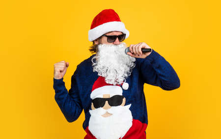 cheerful santa man hipster sing christmas music songs. preparation and celebration. funny party time. happy winter holidays. new year mood. christmas shopping. sales and discounts. buy xmas gifts Stock Photo