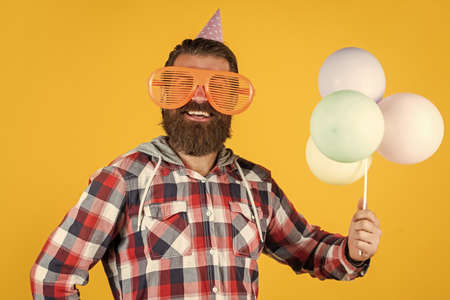 This is for you. Celebrating happy party. Party Elements and holiday objects. Multi colored fun. best party for retirement. cheerful man with beard and moustache. hipster smiling with balloon