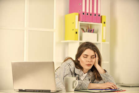 sexy girl in jacket use laptop. tired woman work online on computer. confident office worker. secretary with document folder. formal fashion style. brunette woman with makeup. Concentrated on work 版權商用圖片