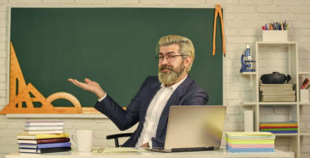 School teacher programming laptop. Learn programming language. Handsome man use modern technology. Digital technology. Programming web development. Apply online course. Selecting specific courses