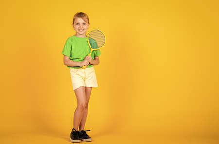 Gym workout of teen girl. Sport game success. Happy child play tennis. Tennis club for kids. Tennis player with racket. Childhood activity. Fitness brings health and energy. copy space Stok Fotoğraf