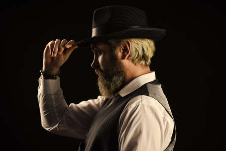 Past centuries trend. Retro gentlemen. Mature handsome man. Man in vintage hat side view. Brutal bearded hipster. Real masculinity. Masculine appearance. Bearded guy black background. Beard grooming
