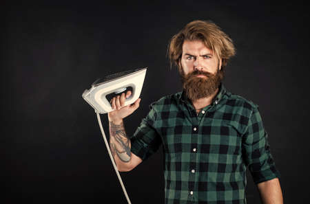 you need iron. Steaming blue iron. happy man with iron. perfect husband duty. bearded male housekeeper. hipster ironing clothes. new technology with high quality. homework and household
