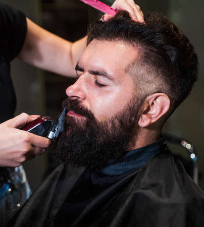 barbershop. male trendy hairdo. perfect haircut with blade razor. barber master cut hair. mature hipster with beard at hairdresser. brutal hipster with moustache making new hairstyle. Hair like fire Standard-Bild