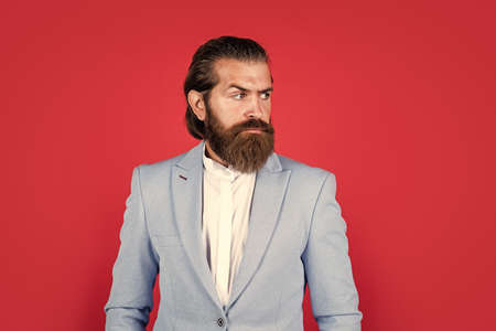 Intelligent Businessman with beard. Bearded Man In classical style. glamour bride groom. man on formal event. male business fashion. hipster wear blue jacket. barbershop concept