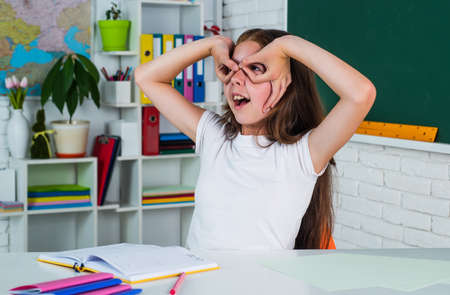 study with fun. home schooling concept. childhood development. get knowledge through study. kid in classroom with chalkboard. child having fun. back to school. formal education in modern life