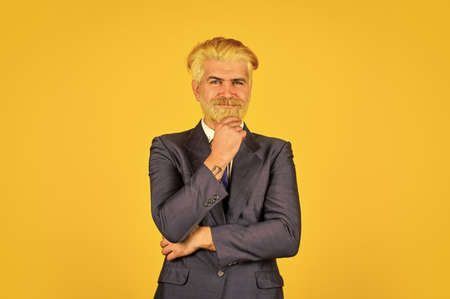 blond hipster with dyed beard hair. professional business manager. Elegant man stylish costume. mature businessman making decision. happy and concentrated boss. bearded ceo in formal suit Standard-Bild