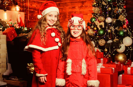 Christmas party time. Winter shopping sales. Little sisters want present. christmas time. Love winter holidays. small girl kids in red santa hat. wait for xmas gift. Happy family celebrate new year