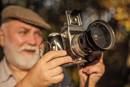 When life gets blurry adjust your focus. Focus Shooting concept. Photography or traveler. looking at his camera in the park. photographing on vintage camera. Hiker videographer on adventure vacation