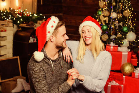 Loving couple christmas tree background. Couple in love enjoy christmas holiday celebration. Boyfriend and girlfriend lovely family celebrate winter holiday. Holiday that is celebrated around world Stock fotó
