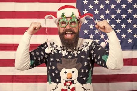 Hooray. All american xmas party. Christmas in usa. Santa on american flag background. Bearded american man celebrate new year. National us flag. Patriotic hipster celebrate winter holidays Standard-Bild