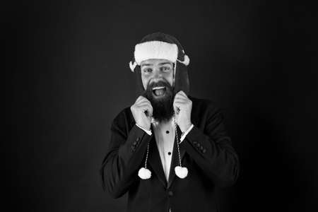 Winter is calling. Happy businessman dark background. Bearded man with winter party look. Winter fashion and accessory. Festive winter season. New year celebration. Merry christmas greetings